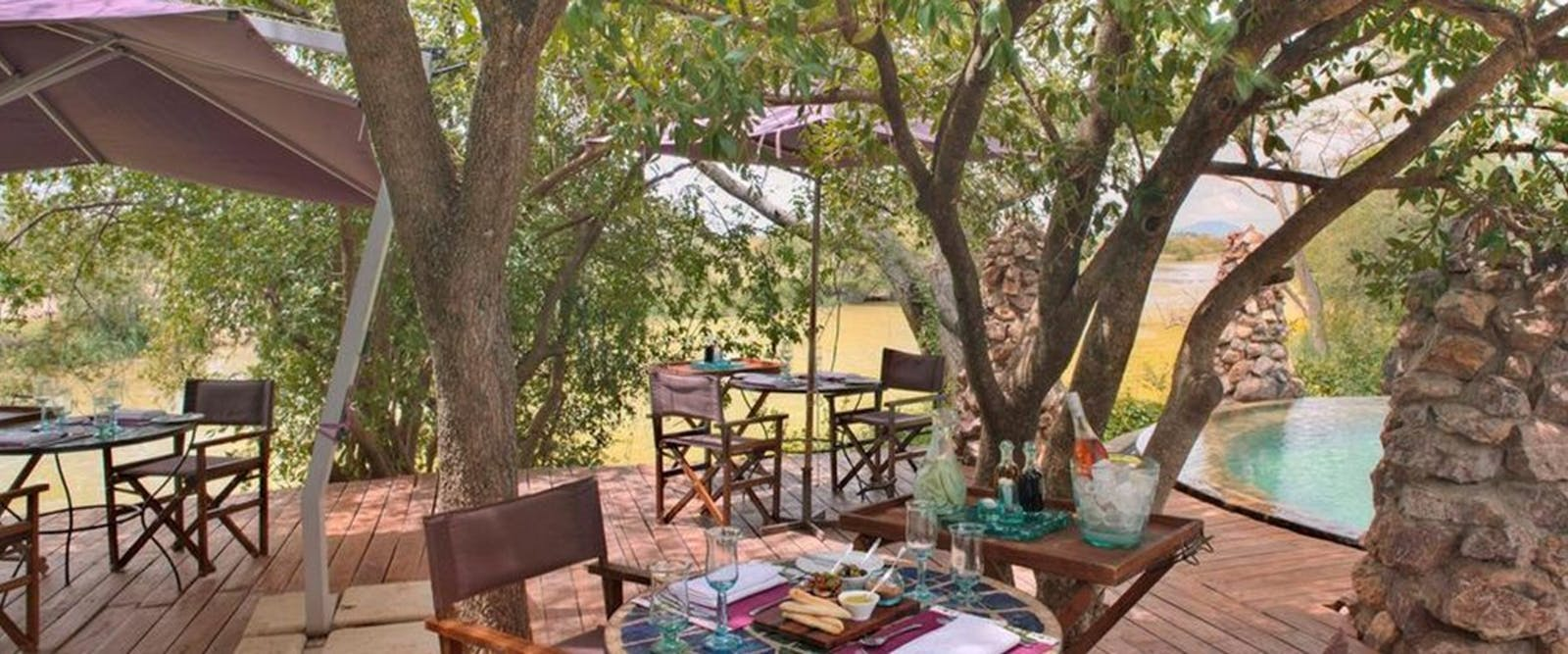 Outdoor dining area at &Beyond Grumeti Serengeti Tented Camp