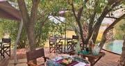 Outdoor dining area at &Beyond Grumeti Serengeti Tented Camp
