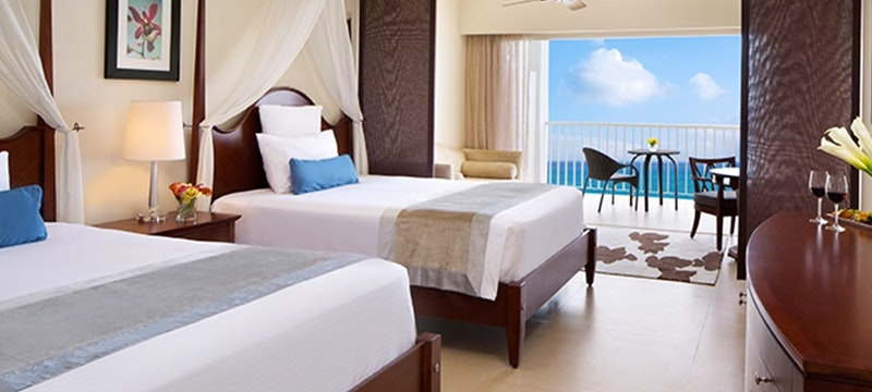 Double bedroom with ocean view at Secrets St James & Secrets Wild Orchid Montego Bay, Jamaica