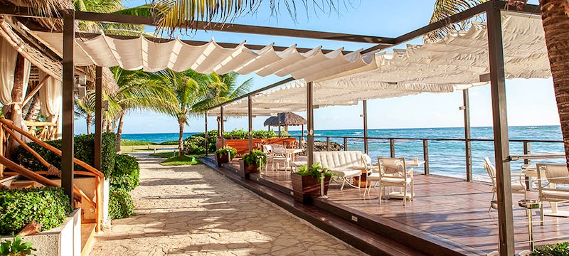 Relax next to the beautiful ocean at Eden Roc at Cap Cana Boutique Suites & Beach Club