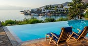 Sunbeds by the pool at Elounda Bay Palace, Crete, Greece