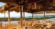Dine with your toes in the sand at Barefoot by the Sea, a restaurant at Sandals Emerald Bay, Bahamas