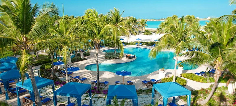The poolside area at Sandals Emerald Bay, Bahamas