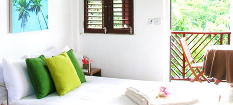 Garden view bedroom at Calibishie Cove