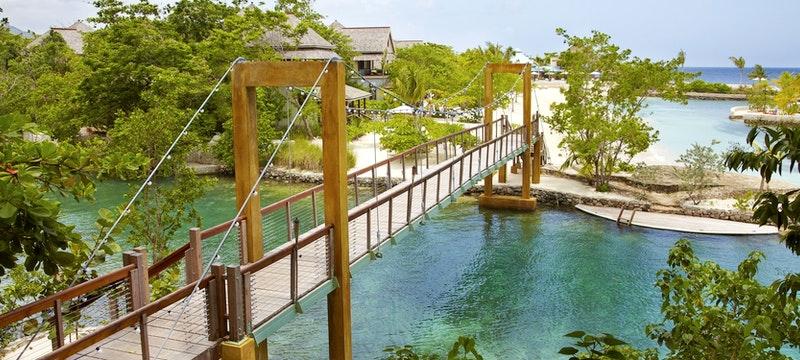 Bridge connecting the resort to the beautiful beach at GoldenEye, Jamaica