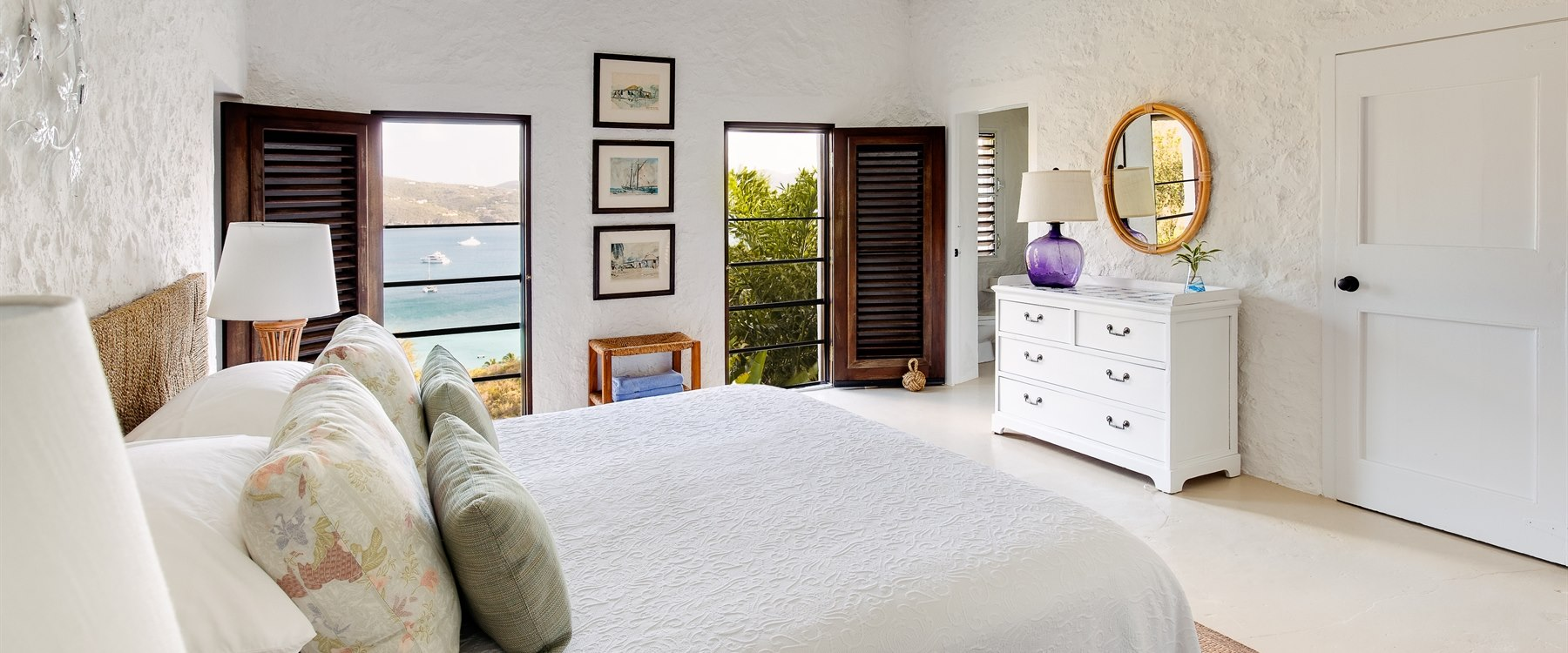 Sea view bedroom at Tennis courts at Guana Island, British Virgin Islands