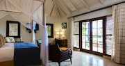 Bedroom interior of a private home at Jumby Bay Estate Homes, Antigua