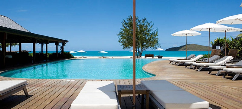 Relax by the pool and enjoy the beautiful surroundings at Hermitage Bay, Antigua