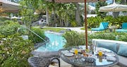 Poolside patio  at Colony Club by Elegant Hotels