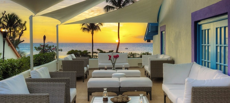 Relax under the sunset on the terrace at Crystal Cove, Barbados