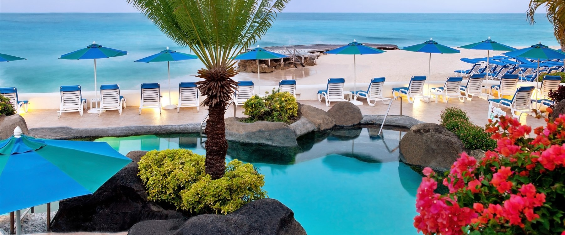 Sun loungers at Crystal Cove by Elegant Hotels, Barbados