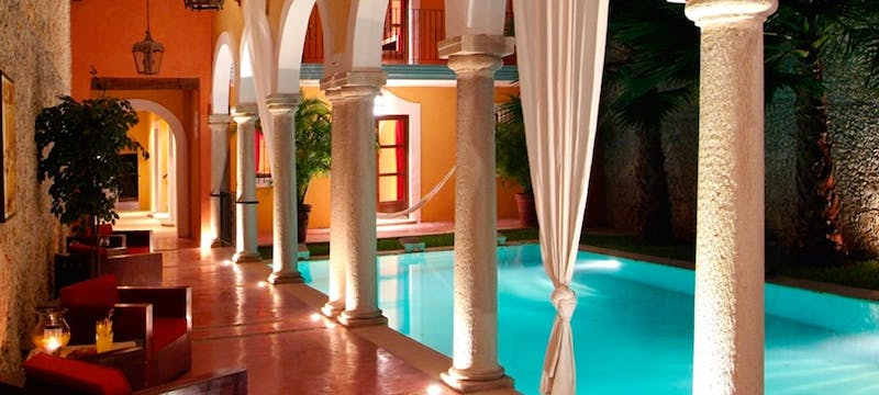 Pool area in the evening at Hacienda Merida