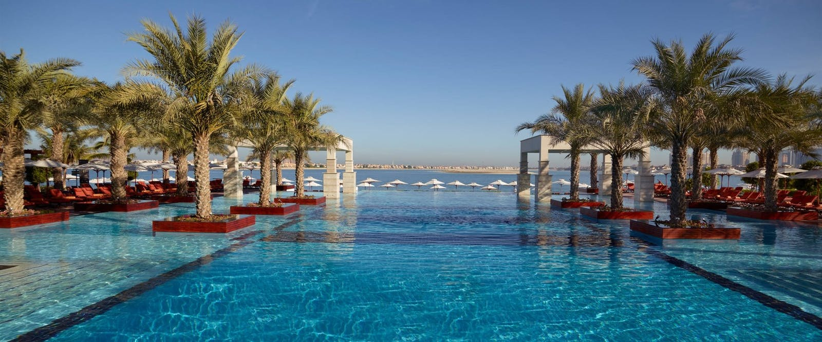 Swimming pool and view at Jumeirah Zabeel Saray, Dubai