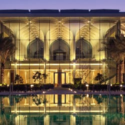 Infinity pool and lobby at Kempinski Hotel Muscat