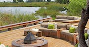Outdoor lounge area at Kings Pool Camp, Bostwana