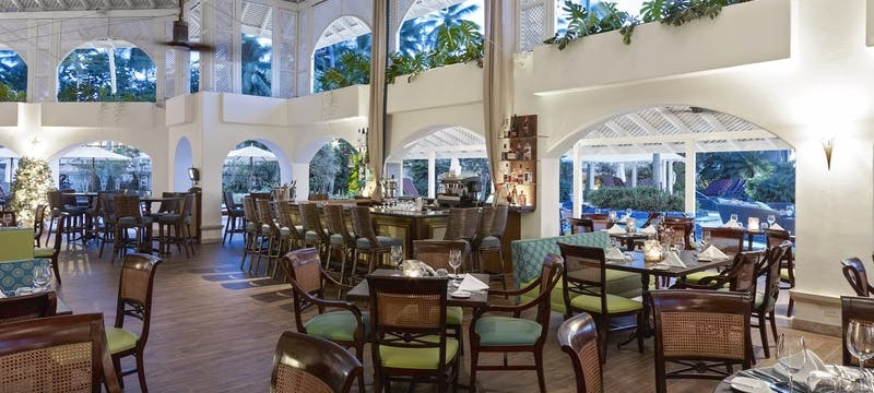 Open air dining restaurant serving breakfast, lunch and dinner at Colony Club, Barbados