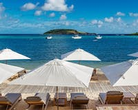 Loungers and view at Le Barthelemy Hotel Spa