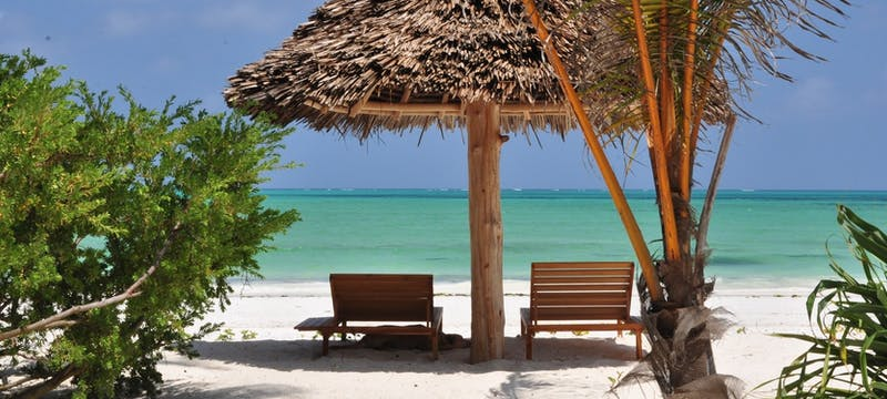 Lounge chairs on the sand at Zanzibar White Sand Luxury Villas and Spa