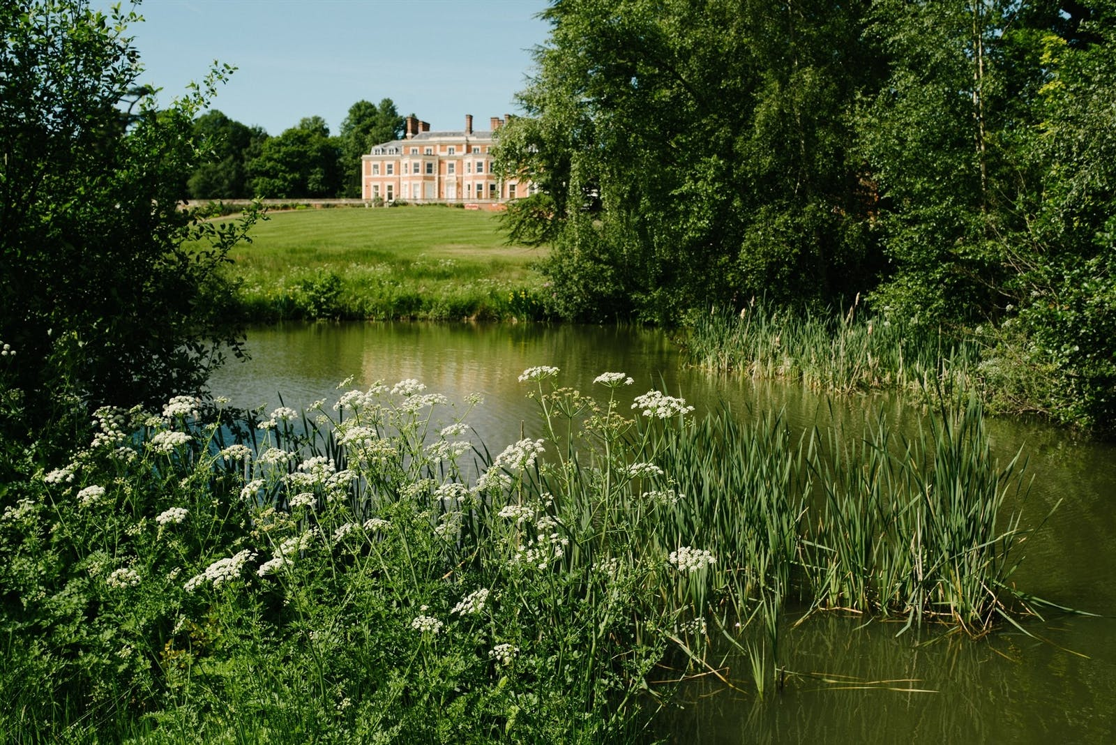 View of Heckfield Place from across the estate's lake