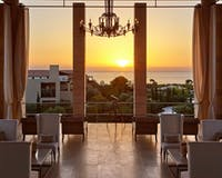 Open air lobby at sunset at The Romanos a Luxury Collection Resort
