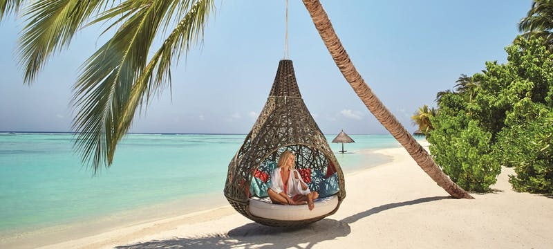 Swinging chair at LUX* South Ari Atoll, Maldives