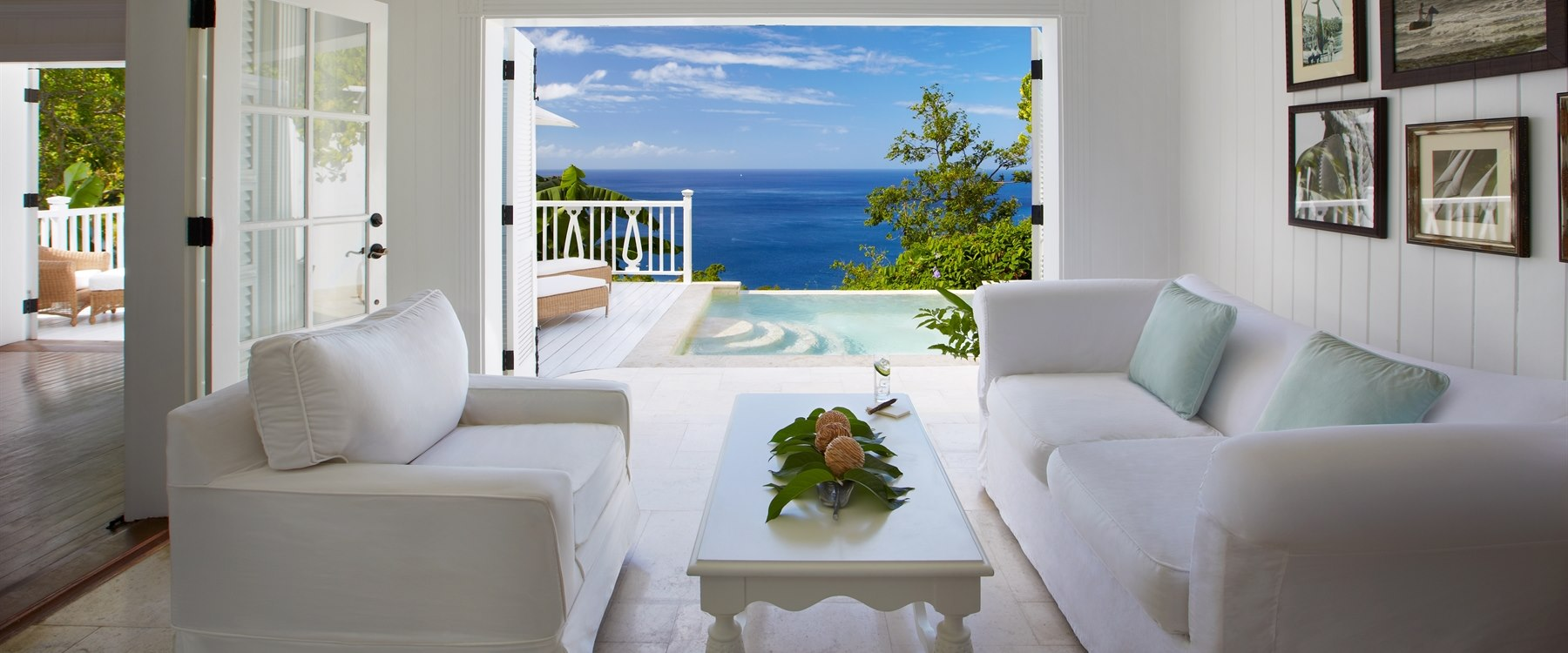 Living room area overlooking the ocean in Luxury Villa at Sugar Beach, A Viceroy Resort
