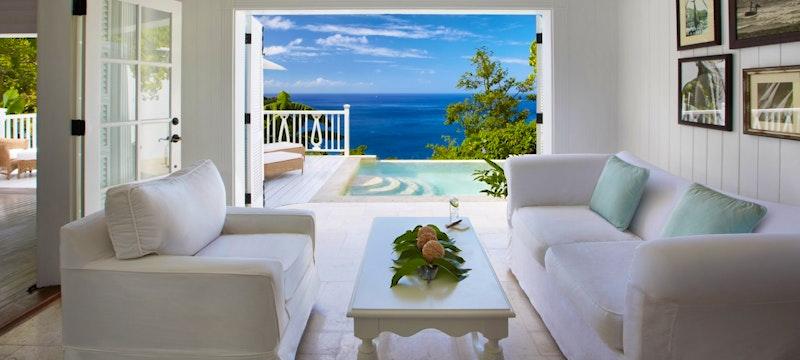 Living room area overlooking the ocean in Luxury Villa at Sugar Beach, A Viceroy Resort