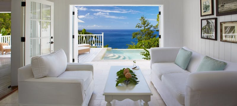 Living room area and terrace in Luxury Villa at The Villas at Sugar Beach, A Viceroy Resort
