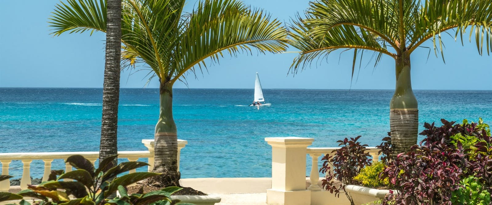 View of The Sea with Sailboat at Coral Reef Club, Barbados