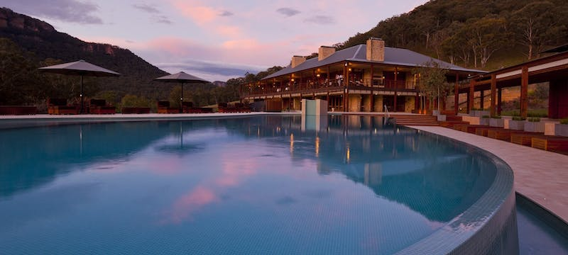 Swimming pool at sunset at Emirates One&Only Wolgan Valley, Australia