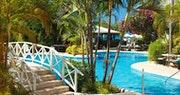 Relax poolside at Mango Bay, Barbados