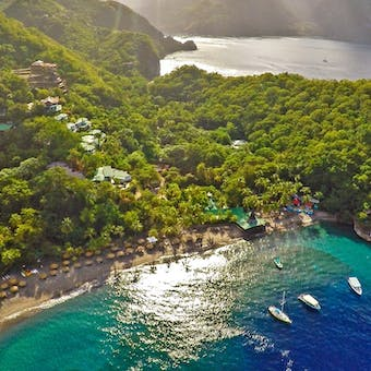 aerial view of anse chastanet and the pitons