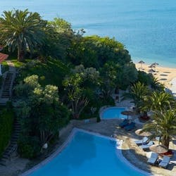 Pool and beach at eagles palace and spa, greece