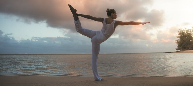 Yoga on the beach at Heritage Le Telfair Golf & Spa Resort, Mauritius