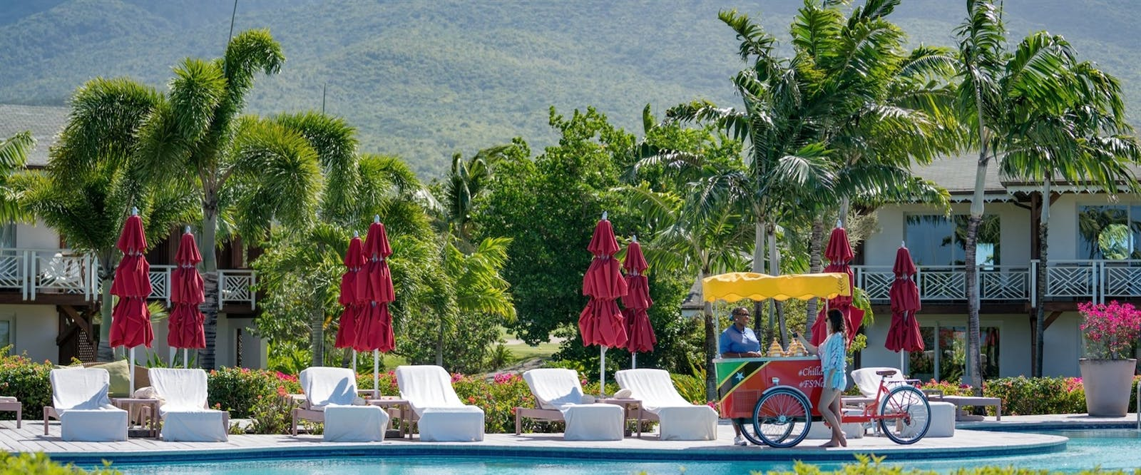 The Pool and loungers at Four Seasons Resort Nevis