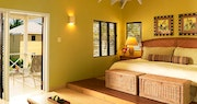 Bedroom with garden view at Nisbet Plantation Beach Club, Nevis