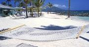 Unwind in a hammock on the shore at Nisbet Plantation Beach Club, Nevis