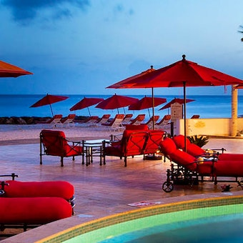 Relax poolside at Ocean Two, Barbados