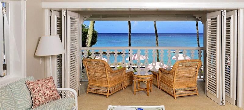 Ocean front suite living room and balcony view at Cobblers Cove, Barbados
