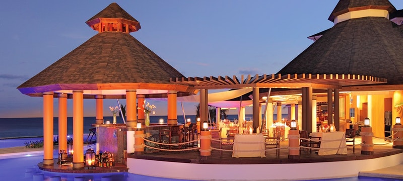 Casual yet elegant poolside bar with a specialty in seafood at Secrets St James & Secrets Wild Orchid Montego Bay, Jamaica