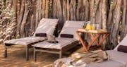 Deck chairs at Okuti Camp
