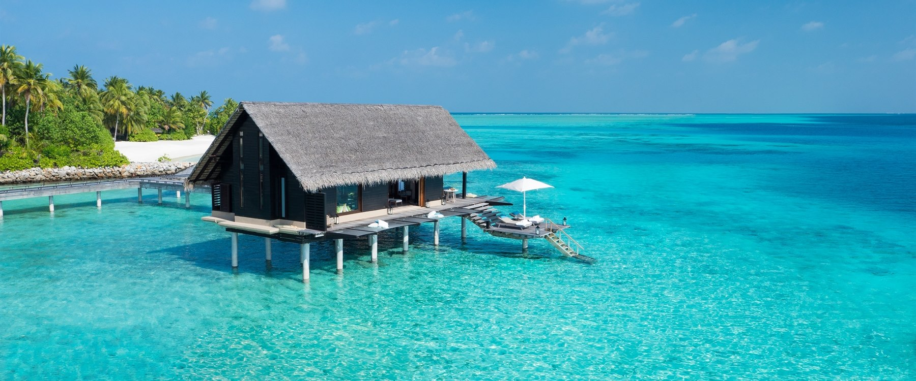 Water villa aerial at One&Only Reethi Rah, Maldives