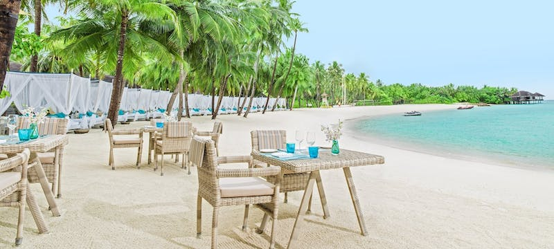 Dining area at the beach club at One&Only Reethi Rah, Maldives