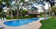 Swimming pool area at The Lodge at Chichen Itza