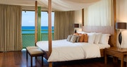 Penthouse bedroom with ocean view at Mango Bay, Barbados