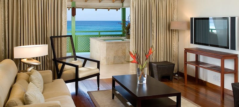 Penthouse living room area overlooking the ocean at Mango Bay, Barbados
