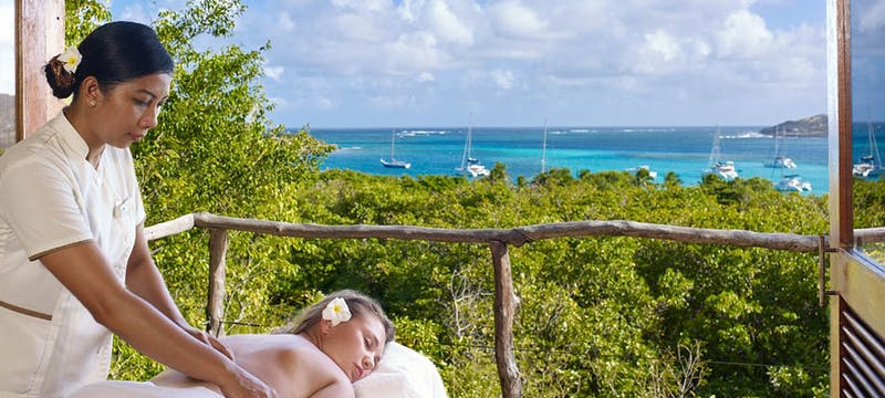 Enjoy a relaxing massage overlooking the ocean at Petit St. Vincent