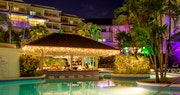 Relaxing pool bar lit up in the evening at Bougainvillea Beach Resort, Barbados
