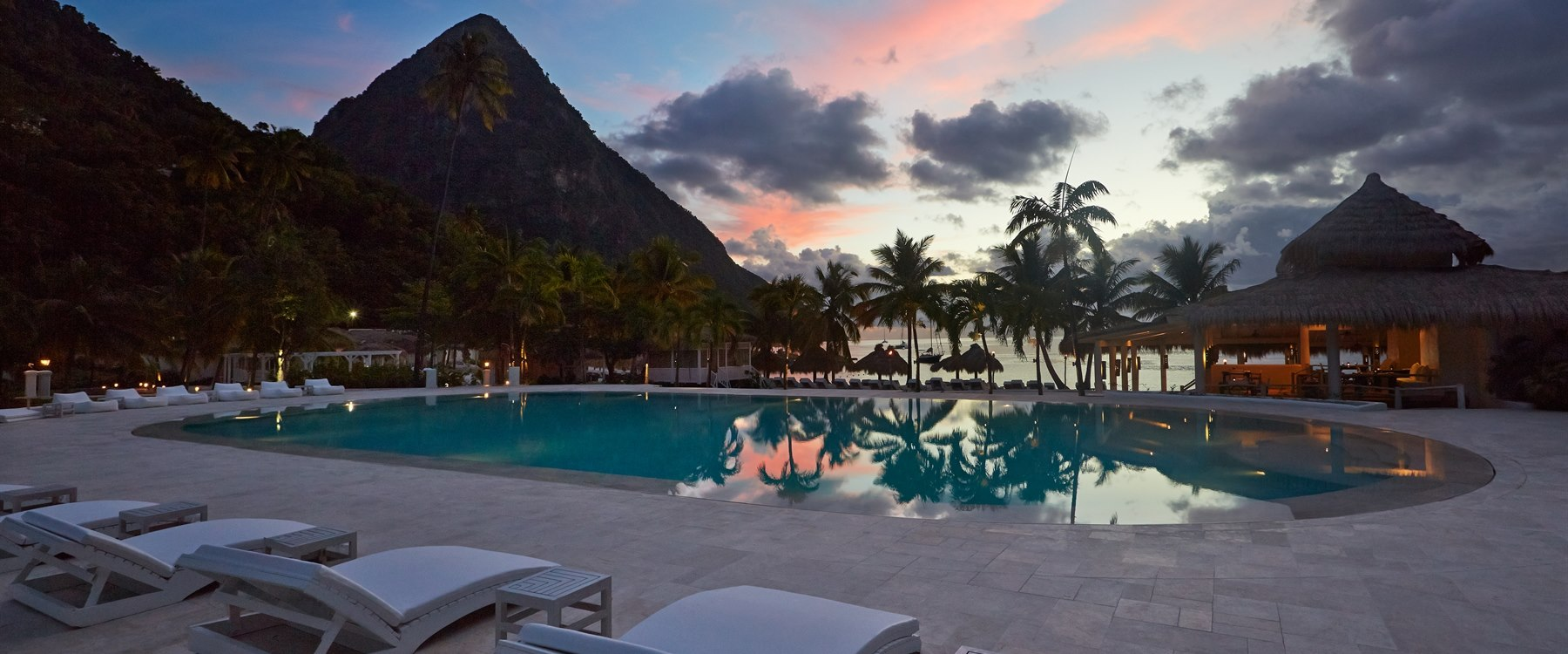 Picturesque pool area in the evening at Sugar Beach, A Viceroy Resort