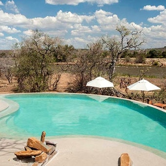 Pool overlooking Ruaha River at Azura Selous Game Reserve